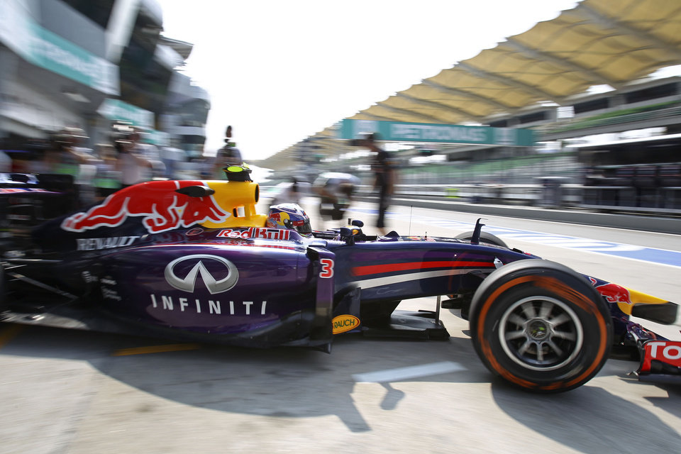 Photo - Red Bull Racing driver Daniel Ricciardo of Australia leaves the pit during the first practice session ahead of Sunday's Malaysian Formula One Grand Prix at Sepang International Circuit in Sepang, Malaysia, Friday, March 28, 2014. (AP Photo/Lai Seng Sin)