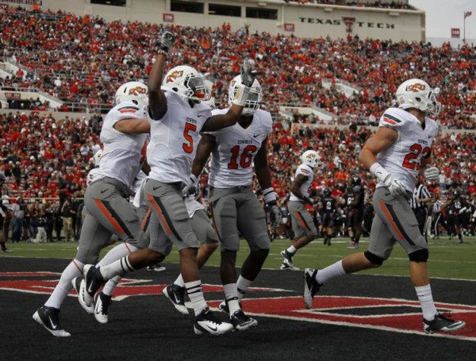 Photo - Oklahoma State's Josh Stewart (5) celebrates a Cowboys fumble recovery on a kick off during a NCCA football game between Texas Tech University (TTU) and Oklahoma State University (OSU) at Jones AT&T Stadium in Lubbock, Texas, Saturday, Nov. 12, 2011. Photo by Sarah Phipps, The Oklahoman  SARAH PHIPPS