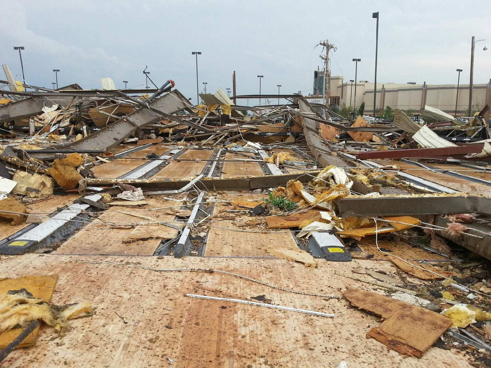 The bowling lanes at AMF Moore Lanes are visible in the rubble after the May 20 tornado. <strong> - Jon Fisher</strong>
