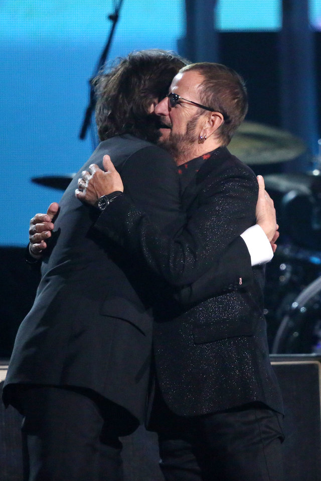 Photo - Paul McCartney, left, embraces Ringo Starr on stage at the 56th annual Grammy Awards at Staples Center on Sunday, Jan. 26, 2014, in Los Angeles. (Photo by Matt Sayles/Invision/AP)