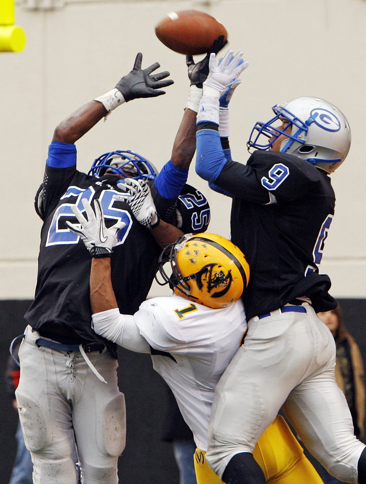 Guthrie's J.T. McFadden (25) and Kai Callins (9) break up a pass intended for Lawton MacArthur's Aaron Finley (1) near the end of the Class 5A high school football state championship game between Guthrie and Lawton MacArthur at Boone Pickens Stadium in Stillwater, Okla., Friday, Dec. 2, 2011. Guthrie won, 24-7. Photo by Nate Billings, The Oklahoman