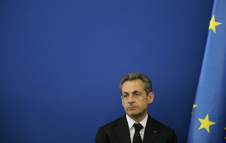 Photo - FILE - This March 10, 2014, file photo shows Former french President Nicolas Sarkozy during the inauguration of the Foundation Claude Pompidou in Nice, southeastern France. Former French President Nicolas Sarkozy has been detained and is reportedly being questioned by financial investigators in a corruption probe that is rattling France's conservative political establishment. (AP Photo/Lionel Cironneau, File)