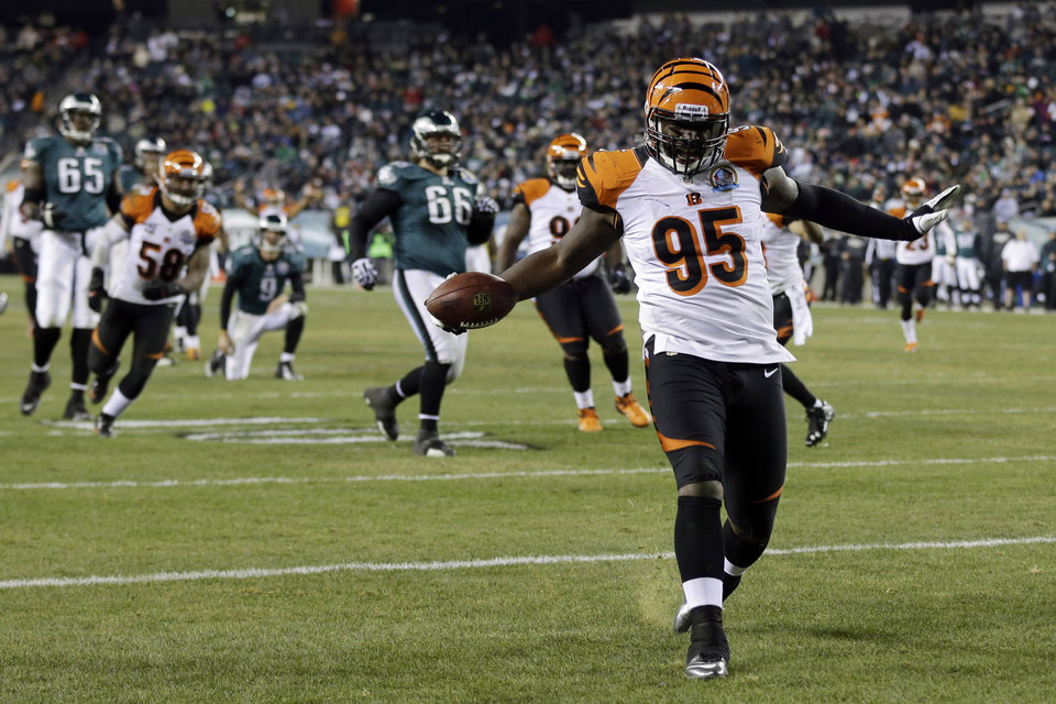Cincinnati Bengals' Wallace Gilberry struts into the end zone for a touchdown after recovering a fumble by the Philadelphia Eagles in the second half of an NFL football game on Thursday, Dec. 13, 2012, in Philadelphia. (AP Photo/Mel Evans)