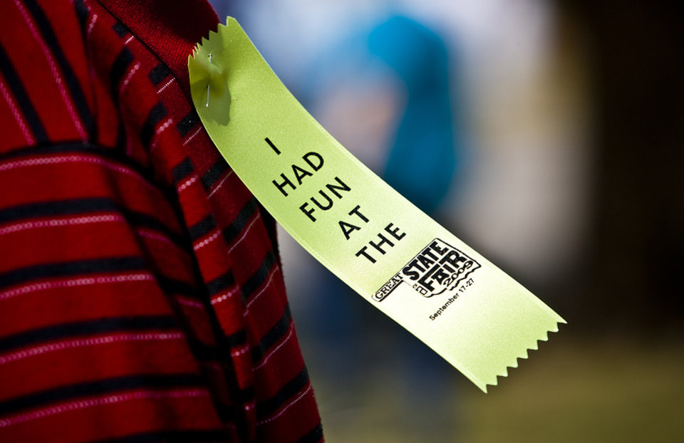 Photo - A fair participant wears a ribbon during Senior Day at the 2009 Oklahoma State Fair at State Fair Park on Wednesday, Sept. 23, 2009, in Oklahoma City, Okla.  Photo by Chris Landsberger, The Oklahoman.