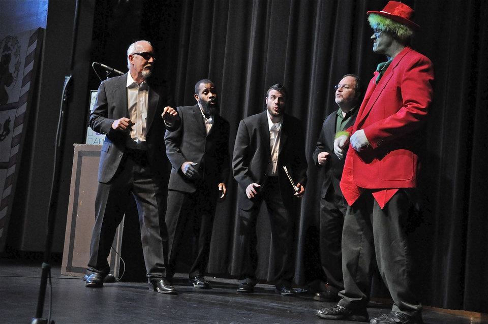 Left: Caleb Henderson, Wes Short, Chuck West, Jovan Morgan and The Grinch perform during the OK Chorale Christmas show.  0 Photos by M. Tim Blake for The Oklahoman