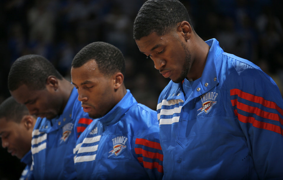 Oklahoma City\'s Perry Jones III (3) stands during the prayer before the preseason NBA game between the Oklahoma City Thunder and the Charlotte Bobcats at Chesapeake Energy Arena in Oklahoma City, Tuesday, Oct. 16, 2012. Photo by Sarah Phipps, The Oklahoman