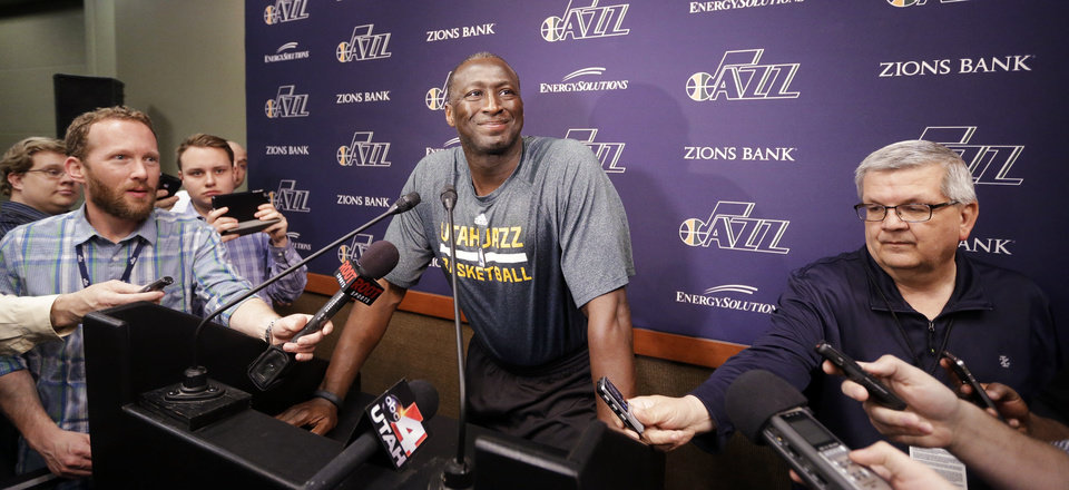 Photo - Utah Jazz coach Tyrone Corbin speaks to reporters on the day the Jazz cleaned out their lockers after a 25-57 season, Thursday, April 17, 2014, in Salt Lake City. (AP Photo/Rick Bowmer)