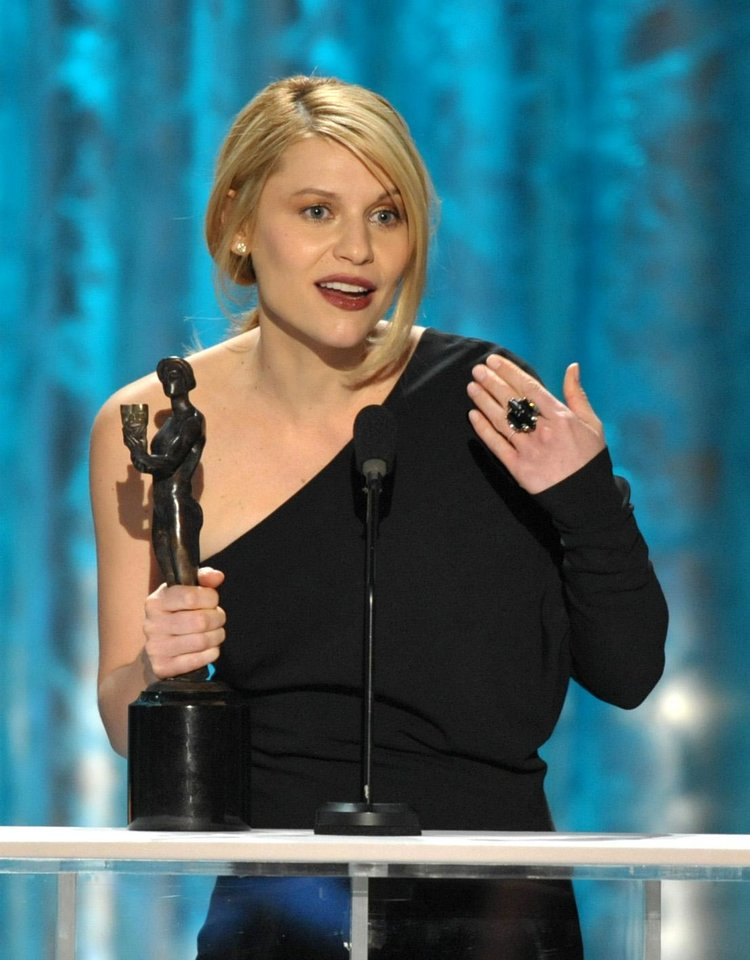 "Photo - Claire Danes accepts the award for outstanding female actor in a drama series for ""Homeland"" at the 19th Annual Screen Actors Guild Awards at the Shrine Auditorium in Los Angeles on Sunday Jan. 27, 2013. (Photo by John Shearer/Invision/AP)"