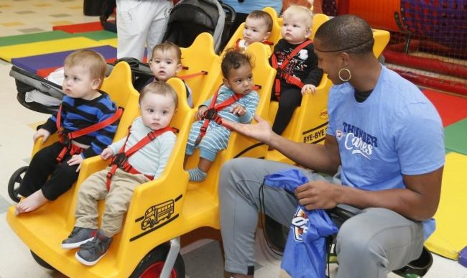 Photo -  Oklahoma City's Devon Hall talks to a group of toddlers on Thursday at Special Care.