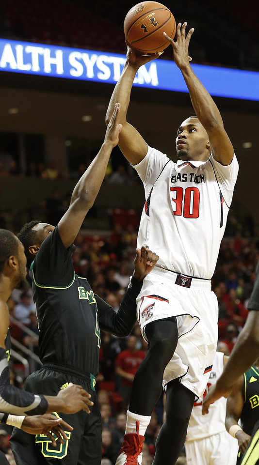 Photo - Texas Tech's Jaye Crockett (30) shoots over Baylor's Gary Franklin during an NCAA college basketball game in Lubbock, Texas, Wednesday, Jan, 15, 2014. (AP Photo/Lubbock Avalanche-Journal, Tori Eichberger) ALL LOCAL TV OUT