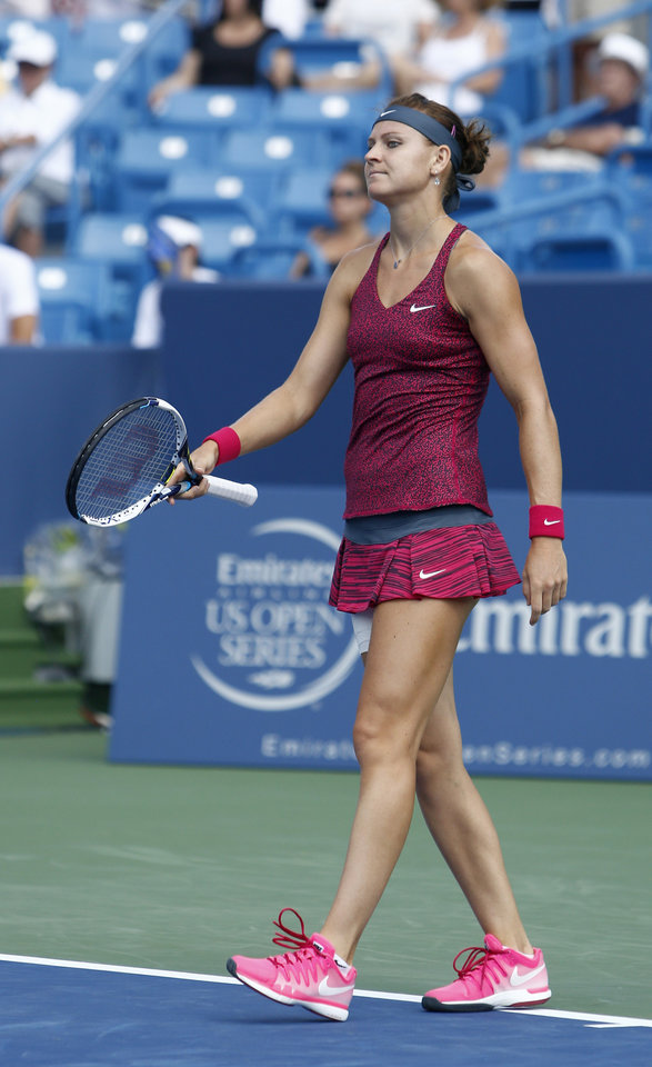 Photo - Lucie Safarova, from Czech Republic, reacts during a first round match with Venus Williams at the Western & Southern Open tennis tournament, Tuesday, Aug. 12, 2014, in Mason, Ohio. (AP Photo/David Kohl)