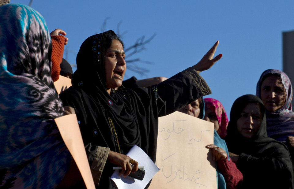 A Pakistani polio worker chants slogans during a demonstration against the killing of their colleagues, Wednesday, Dec. 19, 2012 in Islamabad, Pakistan. Gunmen shot dead a woman working on U.N.-backed polio vaccination efforts and her driver in northwestern Pakistan, officials said, just a day after similar attacks across the country killed five female polio workers. (AP Photo/Anjum Naveed)