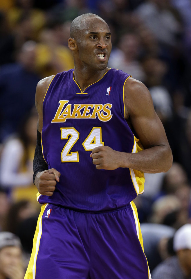 Los Angeles Lakers' Kobe Bryant (24) reacts after scoring against the Golden State Warriors during the second half of an NBA basketball game in Oakland, Calif., Saturday, Dec. 22, 2012. Los Angeles won in overtime 118-115. (AP Photo/Marcio Jose Sanchez)