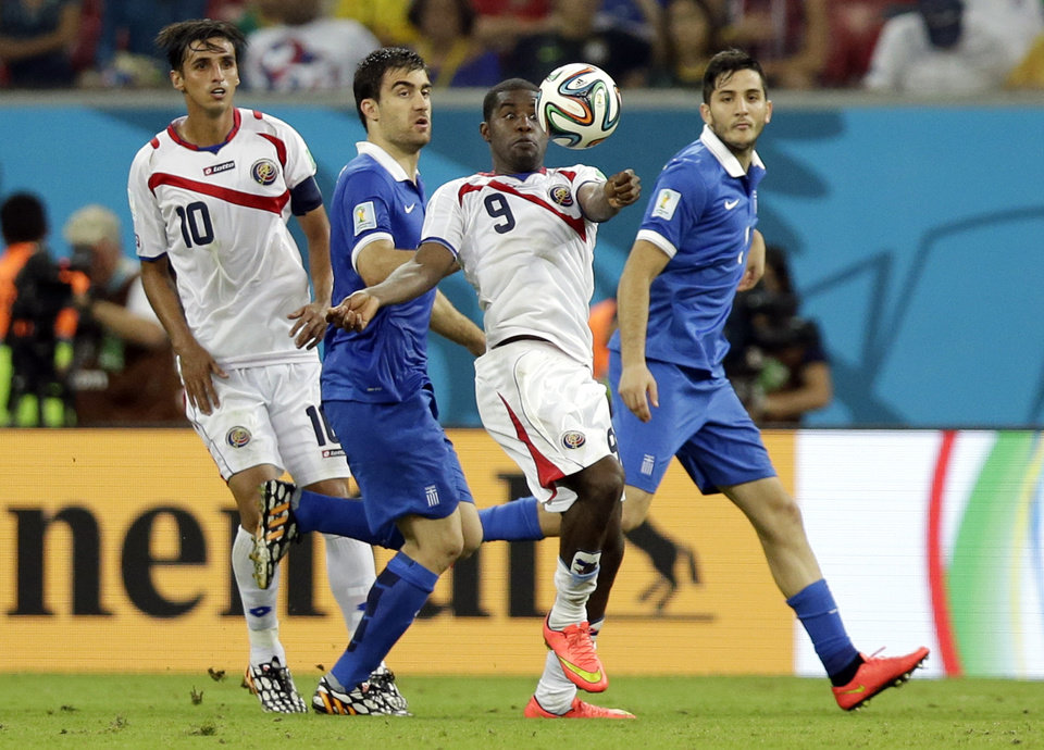 Photo - Costa Rica's Joel Campbell, center, controls the ball during the World Cup round of 16 soccer match between Costa Rica and Greece at the Arena Pernambuco in Recife, Brazil, Sunday, June 29, 2014. (AP Photo/Andrew Medichini)