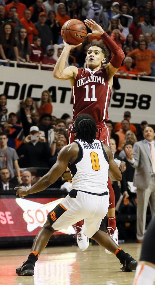 Photo - Oklahoma's Trae Young (11) takes a 3-point shot over Oklahoma State's Brandon Averette (0) at the end of the second half during a Bedlam men's basketball game between the Oklahoma Sooners (OU) and the Oklahoma State Cowboys (OSU) at Gallagher-Iba Arena in Stillwater, Okla., Saturday, Jan. 20, 2018. OSU won 83-81 in overtime. Photo by Nate Billings, The Oklahoman