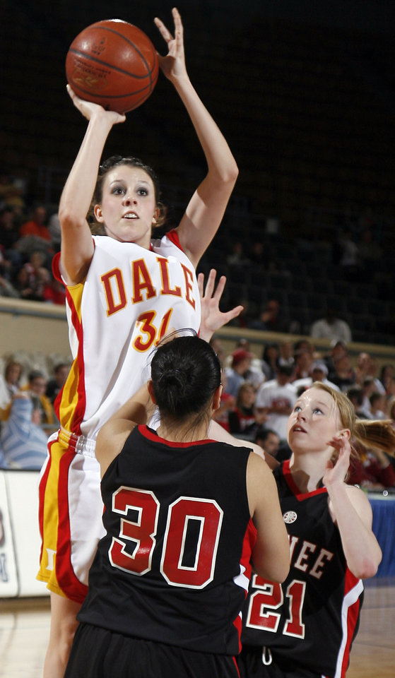 Photo - Dale's Brenna Burnett (1) shoot in front of Pawnee's Christina Pratt (30) and Kelsey Barlow (21) during the girls 2A semifinal between Dale and Pawnee at the State Fair Arena, Friday, March 13, 2009, in Oklahoma City. PHOTO BY SARAH PHIPPS, THE OKLAHOMAN