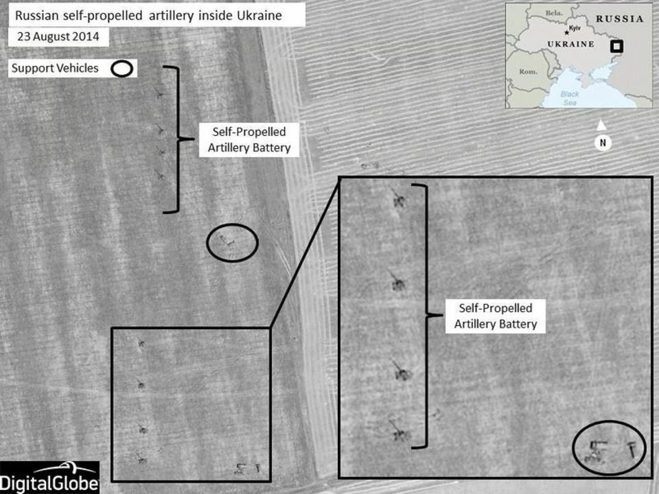 Photo - This Aug. 23, 2014 satellite image made by DigitalGlobe and annotated by NATO shows what the military alliance says are Russian self-propelled artillery units near Krasnodon, Ukraine, inside territory controlled by Russian separatists. On Thursday, Aug. 28, 2014, senior NATO official, Brig. Gen. Nico Tak, said at least 1,000 Russian troops have poured into Ukraine with sophisticated equipment, leaving no doubt that the Russian military had invaded southeastern Ukraine. (AP Photo/NATO, DigitalGlobe)