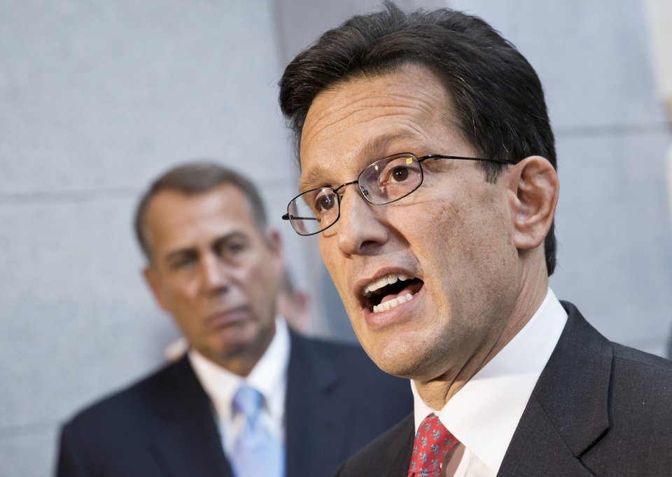 Photo - House Majority Leader Eric Cantor, R-Va., with House GOP leaders, speaks with reporters following a Republican strategy session, at the Capitol in Washington, Tuesday, Oct. 15, 2013.   At left is Speaker of the House John Boehner, R-Ohio.  House GOP leaders Tuesday floated a plan to fellow Republicans to counter an emerging Senate deal to reopen the government and forestall an economy-rattling default on U.S. obligations. But the plan got mixed reviews from the rank and file and it was not clear whether it could pass the chamber.   (AP Photo/J. Scott Applewhite)