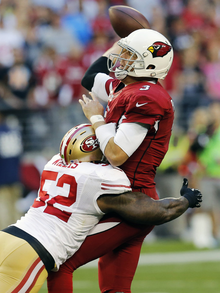 Photo - Arizona Cardinals quarterback Carson Palmer (3) gets the throw off as San Francisco 49ers inside linebacker Patrick Willis (52) hurries him during the second half of an NFL football game, Sunday, Dec. 29, 2013, in Glendale, Ariz. (AP Photo/Matt York)