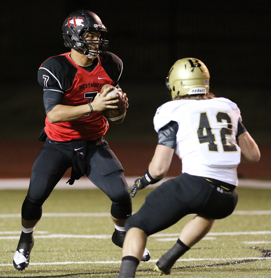 WM #7 QB Bryson Lee tries to avoid BA #42 Alex Bradley during the high school football game between Broken Arrow and Westmoore at Moore stadium Friday , November 8, 2013. Photo by Doug Hoke, The Oklahoman