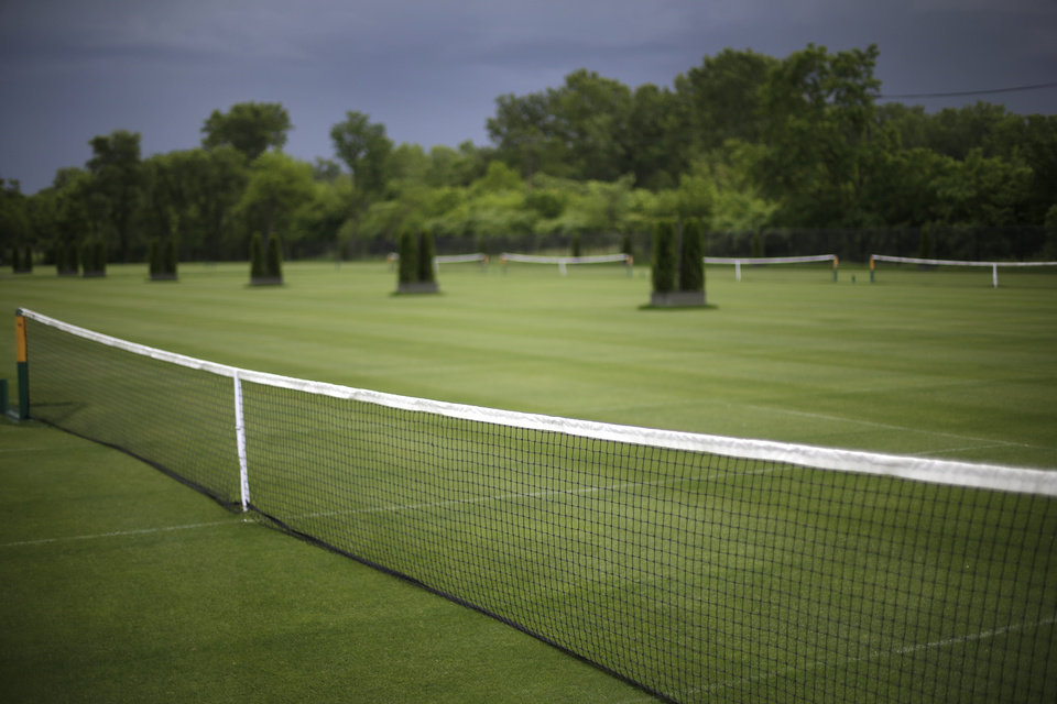 Photo - Part of the Wessen Lawn Tennis Club is seen in Pontiac, Mich., Tuesday, June 24, 2014. The clubs' owner is hoping to impress the ATP Tour enough to bring a tournament to the site in a couple years. Bill Massie says he has spent $1.5 million to build 24 outdoor grass courts, adding he has plans to add seven hard and three clay courts in the future. (AP Photo/Paul Sancya)