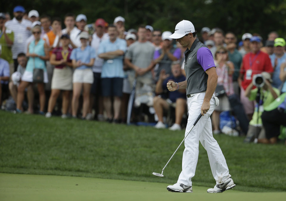 Photo - Rory McIlroy, of Northern Ireland, celebrates his eagle on the 10th hole during the final round of the PGA Championship golf tournament at Valhalla Golf Club on Sunday, Aug. 10, 2014, in Louisville, Ky. (AP Photo/Jeff Roberson)