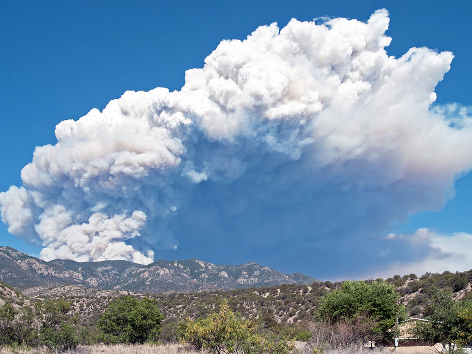 A plume of smoke rises Tuesday from the Whitewater fire burning in the Gila Wilderness east of Glenwood, N.M. AP photo