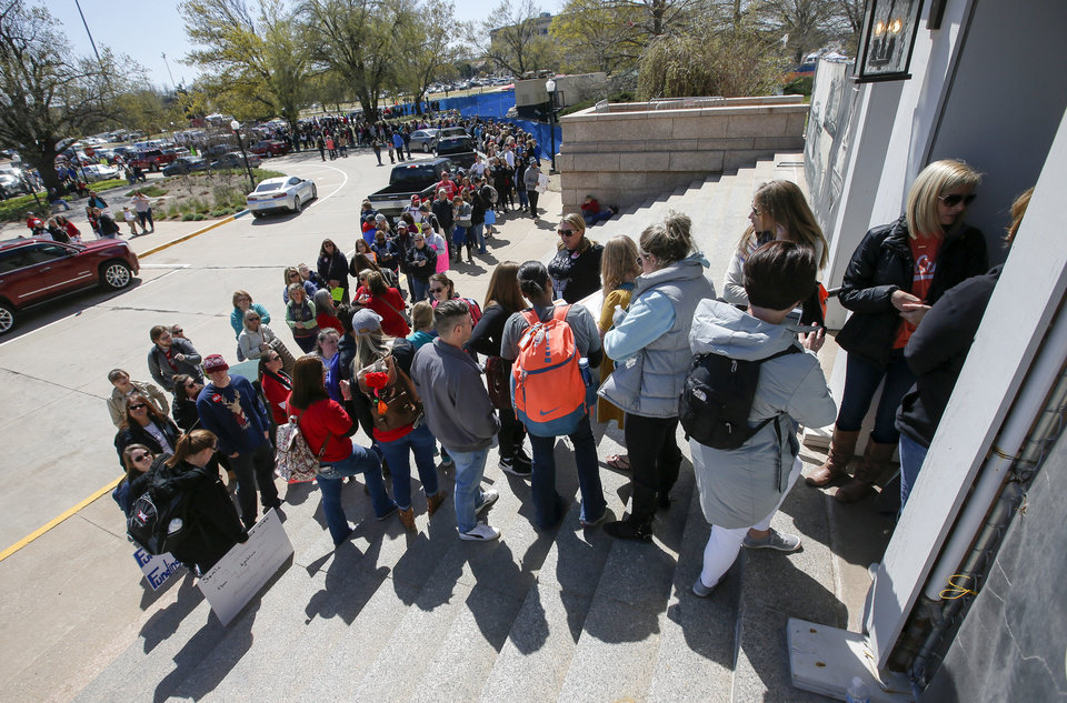 Photo - Teachers, students and supporters of increased education funding wait at an east entrance to enter the state Capitol during the third day of a walkout by Oklahoma teachers, in Oklahoma City, Wednesday, April 4, 2018. The Capitol was filled to capacity and people were allowed in only after others left. Photo by Nate Billings, The Oklahoman