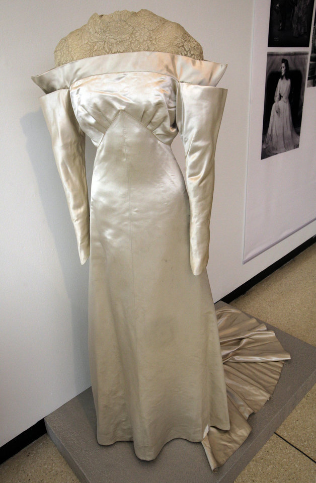 Photo -   A white satin and lace wedding dress by Howard Greer, from the 1934 production of