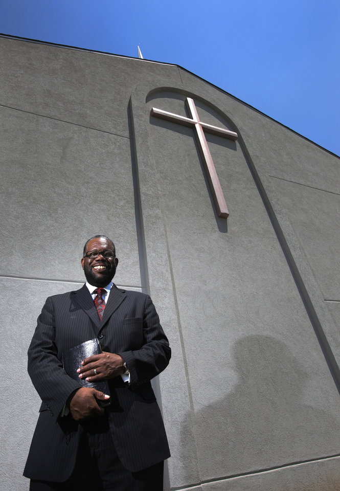Photo - The Rev. Ray Douglas, senior pastor of Greater Mount Olive Baptist Church, stands outside the northeast Oklahoma City house of worship at 1020 NE 42.   Garett Fisbeck - Garett Fisbeck