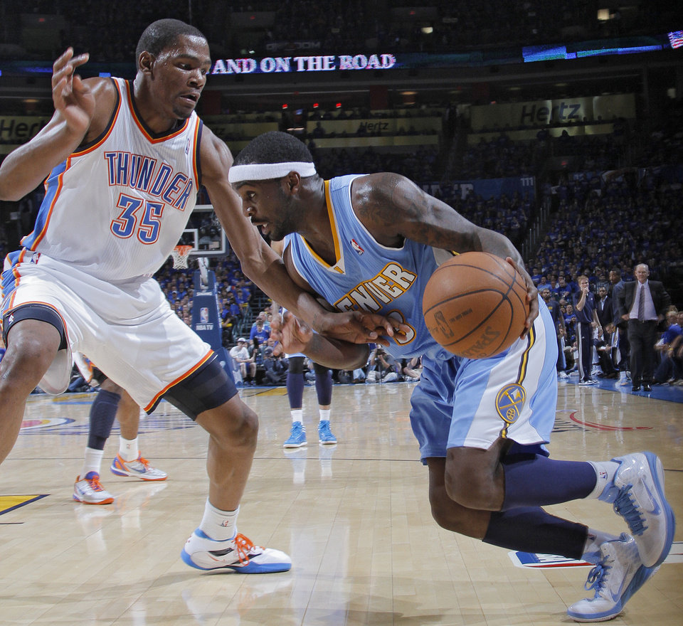 Photo - Oklahoma City's Kevin Durant (35) defends on Denver's Ty Lawson (3)during the first round NBA playoff game between the Oklahoma City Thunder and the Denver Nuggets on Sunday, April 17, 2011, in Oklahoma City, Okla. Photo by Chris Landsberger, The Oklahoman