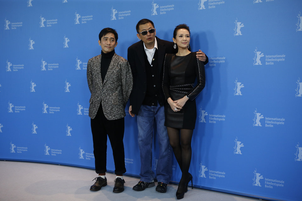 Photo - Actor Tony Leung, Director Wong Kar Wai and actress Zhang Ziyi pose for photographers at the photo call for the film The Grandmaster at the 63rd edition of the Berlinale, International Film Festival in Berlin, Thursday, Feb.7,2013. (AP Photo/Gero Breloer)