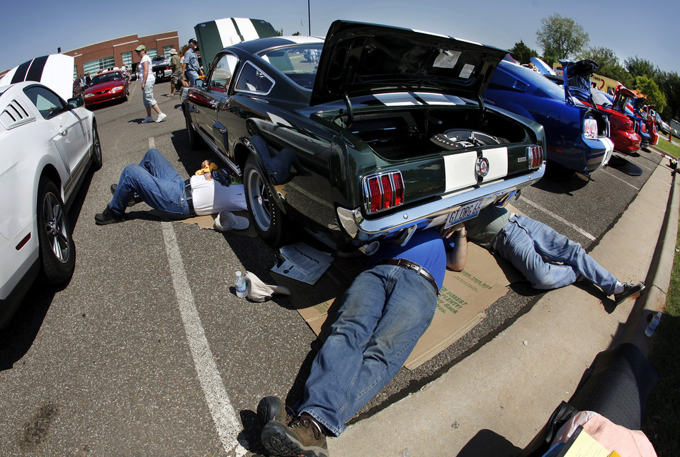 A team of judges scrutinizes the underneath of this 1966 Mustang GT. The city of Mustang hosted Ford Mustang Grand National car show over the weekend. Photos by Jim Beckel, The Oklahoman