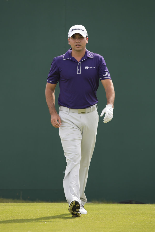 Photo - Jason Day of Australia walks off the 1st tee during a practice round at the Royal Liverpool Golf Club prior to the start of the British Open Golf Championship, in Hoylake, England, Saturday, July 12, 2014. The 2014 Open Championship starts on Thursday, July 17. (AP Photo/Jon Super)