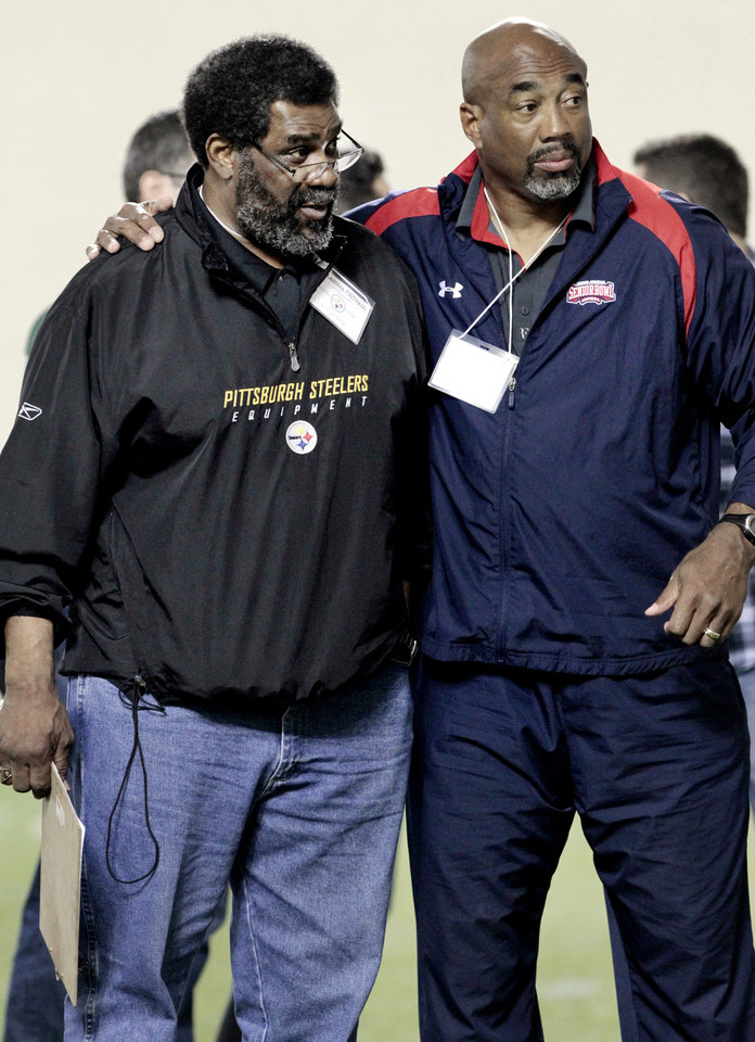 """Mean"" Joe Greene and former University of Oklahoma assistant coach Johathan Hayes watch players at the University of Oklahoma (OU)'s football team's annual Pro Day workouts on Wednesday, March 14, 2012, in Norman, Okla.  Photo by Steve Sisney, The Oklahoman"