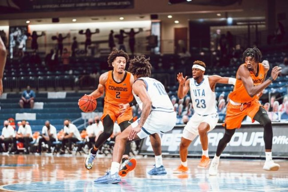 Photo -  OSU freshman Cade Cunningham (2) had 21 points and 10 rebounds in his college debut Wednesday in a 75-68 win at UT-Arlington. [Courtney Bay/OSU Athletics]