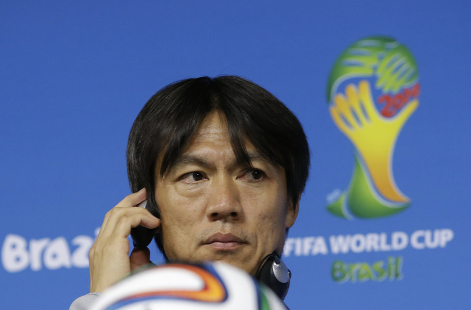 Photo - South Korea national soccer team coach Hong Myung-bo listens to reporter's question during a press conference the day before the group H World Cup soccer match between South Korea and Belgium at the Itaquerao Stadium in Sao Paulo, Brazil, Wednesday, June 25, 2014.  (AP Photo/Lee Jin-man)