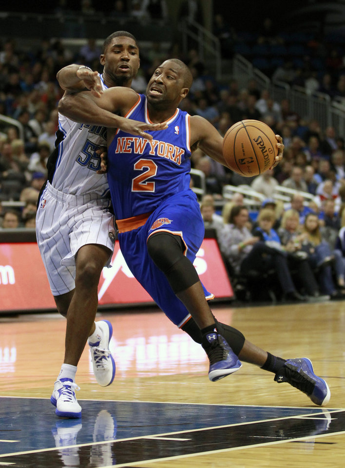 Photo -   New York Knicks' Raymond Felton (2) drives past Orlando Magic's E'Twaun Moore (55) during the first half of an NBA basketball game, Tuesday, Nov. 13, 2012, in Orlando, Fla. (AP Photo/John Raoux)