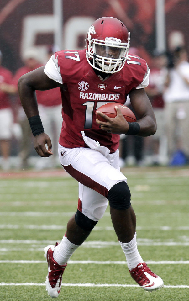 Photo -   Arkansas quarterback Brandon Mitchell carries against Alabama during the first quarter of an NCAA college football game in Fayetteville, Ark., Saturday, Sept. 15, 2012. (AP Photo/Danny Johnston)