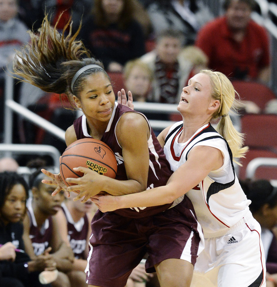 Photo -   Eastern Kentucky's Jasmine Stafford, left, attempts to keep the ball away from Louisville's Shelby Harper during the second half of their NCAA college basketball game, Wednesday, Nov. 28, 2012, in Louisville, Ky. Louisville won 76-42. (AP Photo/Timothy D. Easley)