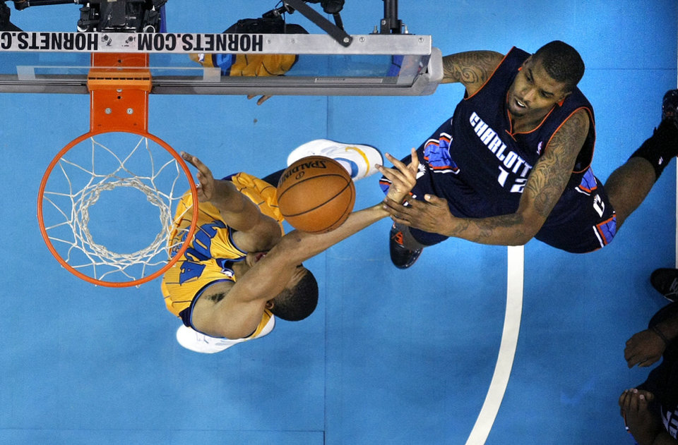 Photo -   Charlotte Bobcats power forward Tyrus Thomas (12) stops New Orleans Hornets power forward Anthony Davis, left, from reaching the basket in the first half of an NBA basketball game in New Orleans, Friday, Nov. 9, 2012. (AP Photo/Gerald Herbert)