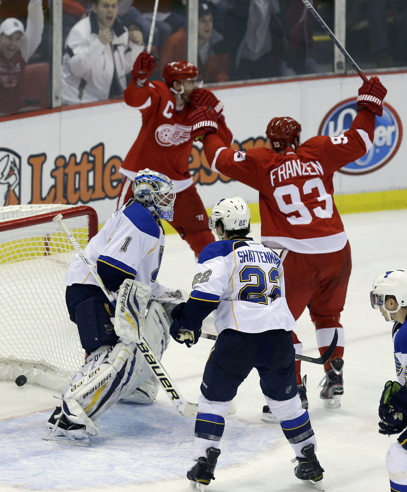 Photo - Detroit Red Wings' Johan Franzen (93) and Henrik Zetterberg, both of Sweden, celebrate the game-winning goal by teammate Pavel Datsyuk, not in frame, past St. Louis Blues goalie Brian Elliott (1) during the third period of an NHL hockey game in Detroit, Friday, Feb. 1, 2013. (AP Photo/Carlos Osorio)