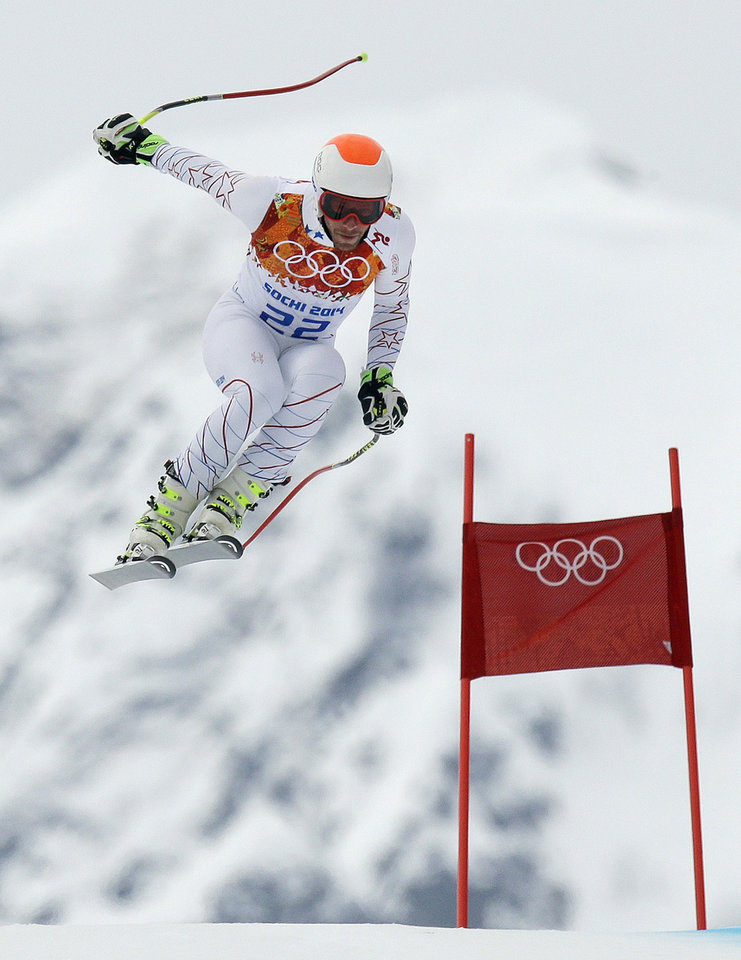 Photo - United States' Bode Miller makes a jump during Men's super combined downhill training at the Sochi 2014 Winter Olympics, Tuesday, Feb. 11, 2014, in Krasnaya Polyana, Russia. (AP Photo/Luca Bruno)