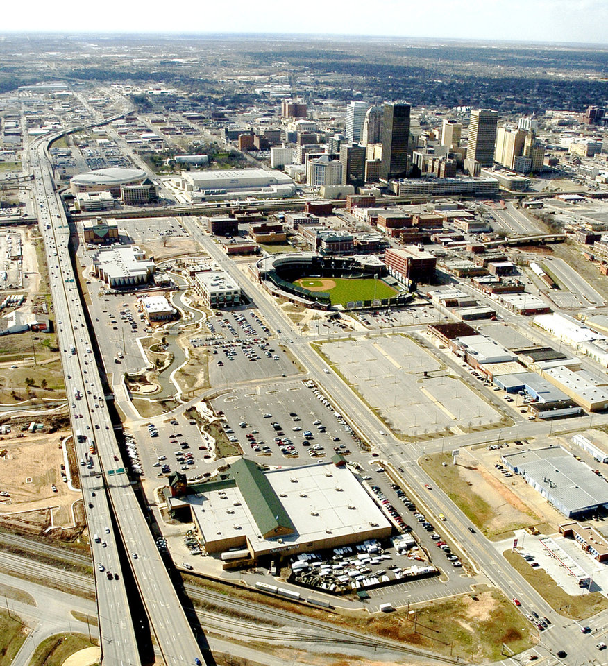 OKLAHOMA CITY / SKYLINE / AERIAL VIEW I-40: This is an aerial of downtown Oklahoma City, taken March 7, 2005. Interstate 40 is shown at left running next to the Ford Center, at top left of photo. The lower left building is Bass Pro Shops. The photo also showcases the SBC Bricktown Ballpark. Staff photo by Bill Waugh/The Oklahoman.