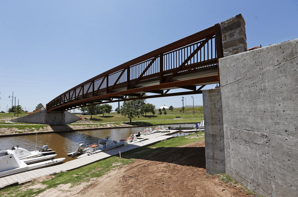 Photo - A new pedestrian bridge over the river inlet extension connecting the Boathouse District along the Oklahoma River under the new Interstate 40 to Lower Bricktown.  NATE BILLINGS - NATE BILLINGS