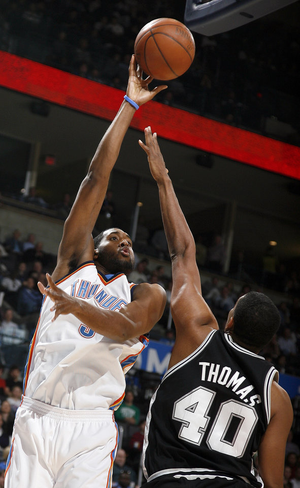 Photo - Oklahoma City's D.J. White (3) shoots over San Antonio's Kurt Thomas (40) during the NBA game between Oklahoma City and San Antonio, Tuesday April 7, 2009, at the Ford Center in  Oklahoma CIty. Photo by Sarah Phipps, The Oklahoma
