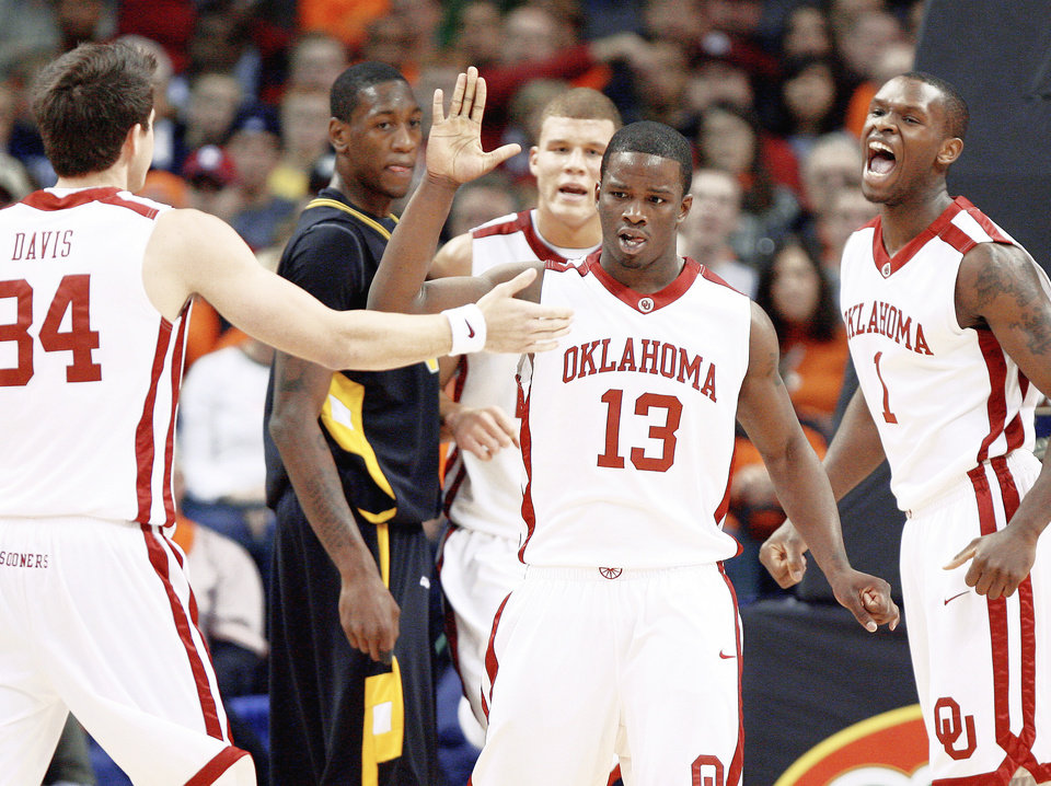 "Photo - OU's Willie Warren, center, celebrates with Cade Davis (left), Blake Griffin (back) and Ryan Wright during the Sooners' win over VCU on Dec. 20. One of the reasons Warren came to OU was to have the opportunity to play with Griffin. Griffin's presence is having a trickle-down effect on the program, which could bring in a pair of McDonald's All-Americans in Tommy Mason-Griffin and Keith ""Tiny"" Gallon. PHOTO BY BRYAN TERRY, THE OKLAHOMAN"