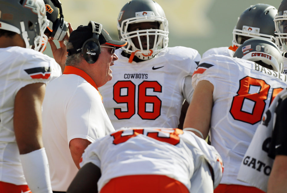 Photo - OSU defensive coordinator Bill Young talks to players during a college football game between the Oklahoma State University Cowboys (OSU) and the Baylor University Bears at Floyd Casey Stadium in Waco, Texas, Saturday, Dec. 1, 2012. Photo by Nate Billings, The Oklahoman