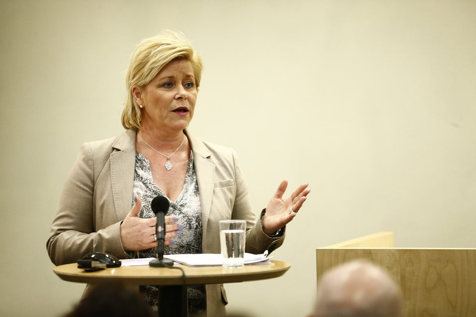 Photo - Norwegian Minister of Finance Siv Jensen presents the parliamentary report of the Norwegian Pension fund (Oil fund) in Oslo, Friday, April 4, 2014. Norway is considering excluding foreign oil and coal companies from its $860 billion sovereign wealth fund, which manages profits from Norway's own fossil fuel industry. In a shakeup of the fund that sharpens its environmental focus, Finance Minister Siv Jensen said she had appointed a panel to assess the question on the grounds of possible damage to the climate. It will report back to the government in November. The move highlights Norway's ambition to be a climate leader globally, while continuing to hunt for oil and gas in its own waters. (AP Photo/Erlend Aas, NTB Scanpix)     NORWAY OUT