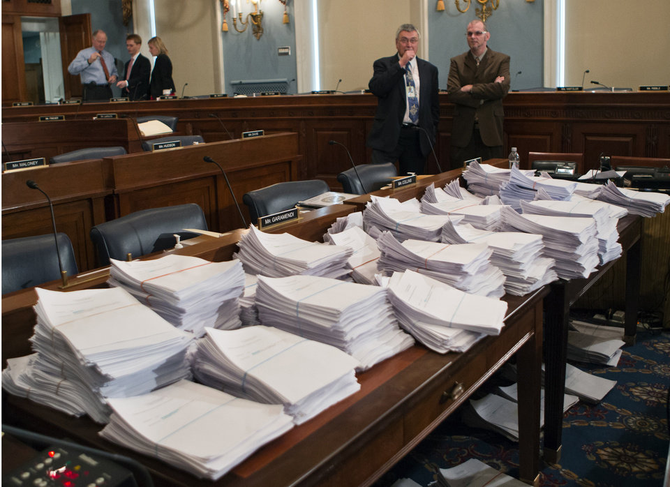 Photo - FILE - This May 15, 2013 file photo shows stacks of paperwork awaiting members of the House Agriculture Committee on Capitol Hill in Washington, Wednesday, May 15, 2013, as it meets to consider proposals to the 2013 Farm Bill. The House has rejected a five year, half-trillion-dollar farm bill that would have cut $2 billion annually from food stamps and let states impose broad new work requirements on those who receive them. (AP Photo/J. Scott Applewhite, File)